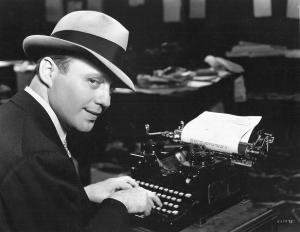 Jack Benny at typewriter